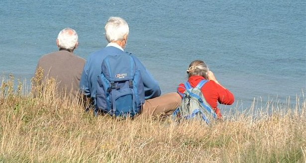 birders overlooking sea